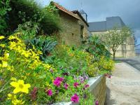 Idée de Sortie Gruyères EVIGNY, Village Fleuri 2 Fleurs
